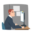 young man working on computer in office vector image