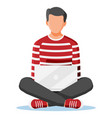 man sitting cross-legged and working on laptop vector image