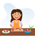 cute happy little kid is cooking vegetables vector image