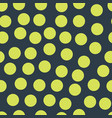 random placed polka dots lime on dark blue pattern vector image