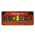 welcome to venice beach vintage rusty metal sign vector image vector image