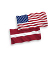 flags of latvia and america on a white background vector image vector image