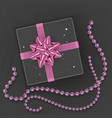a realistic black gift box decorated with a pink vector image vector image