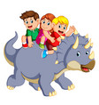children are sitting on the triceratops vector image vector image
