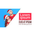 couple wearing santa hats hold banner with copy vector image vector image