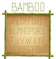 green bamboo alphabet inside of wooden stick vector image vector image
