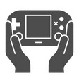 gamepad in hands solid icon joypad in arms vector image vector image