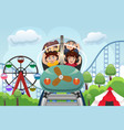 children playing in a amusement park vector image vector image