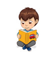 boy reading yellow book calmly vector image vector image