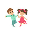 cute smiling little boy and girl dancing vector image vector image