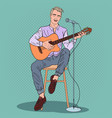 man playing on guitar and singing song pop art vector image