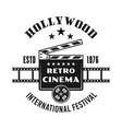 cinema vintage emblem with clapperboard vector image