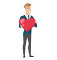caucasian groom holding a big red heart vector image vector image