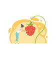 young woman picking huge cloudberry berries vector image vector image