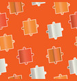 seamless pattern - puzzle pieces in orange colors vector image