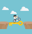 businessmen drive a bike through steep cliffs vector image vector image