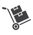 hand truck with cardboard boxes glyph icon vector image