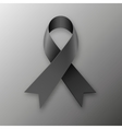 Black awareness ribbon on dark background vector image