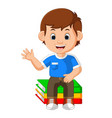 kids boy sitting on big book cartoon vector image vector image