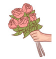 pink rose flower in female hand holding bouquet on vector image vector image