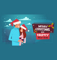 happy couple in santa hats embracing on merry vector image