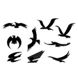 silhouette set flying birds vector image vector image
