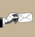 hand with a postal envelope vector image