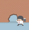 Businessman breaking the wall with hammer vector image
