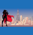 superheroine standing tall city silhouette vector image vector image