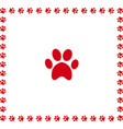 red animal pawprint icon framed with paw prints vector image vector image