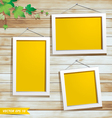 White photo frame on wood background vector image