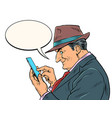 an elderly businessman with a smartphone the boss vector image vector image