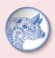 decorative plate with blue patterned head of a vector image