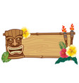tiki mask and wooden frame for text vector image vector image