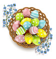 easter eggs with wicker dish vector image