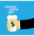 Hand holds a paper cup of hot drink vector image