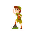 boy scout character in uniform observing something vector image vector image