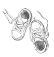 Hand drawn pair of kids shoes vector image