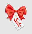 red bow ribbon and tag sale isolated vector image vector image