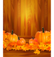 Pumpkins on wooden background with leaves Autumn vector image vector image