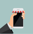 hand holding smartphone with shop online vector image vector image