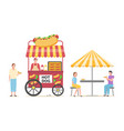 hot dog selling spot and customers eating food vector image vector image