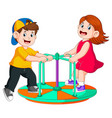 two children are playing on round boat vector image vector image