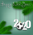 soccer ball and 2020 on a christmas tree branch vector image vector image