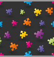 seamless background composed of puzzle pieces vector image