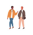 two diverse guys talking and walking outdoor vector image