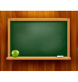 Blackboard with green apple on wooden background vector image vector image