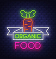 organic food- neon sign on brick wall background vector image