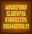 retro yellow neon alphabet with numbers on dark vector image vector image