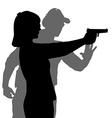 Instructor assisting woman aiming hand gun at vector image